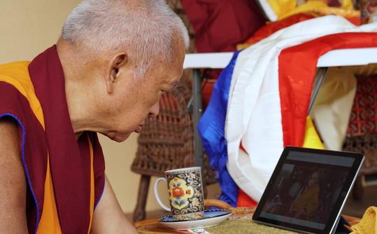 Lama Zopa Rinpoche watching His Holiness the Dalai Lama on an iPad, Taos, New Mexico, USA, July 2017. Photo by Ven. Lobsang Sherab.