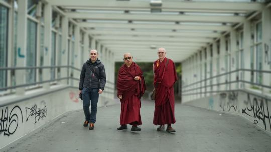 Markus Igel, Lama Zopa Rinpoche and Ven. Roger walking to subway in Vienna, Austria, September 2017. Photograph by Lobsang Sherab.