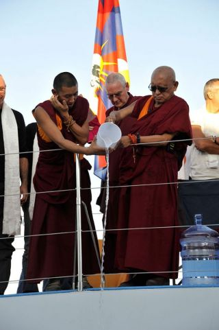 Lama Zopa Rinpoche pouring blessed water into the the Marina Cala de' Medici, Italy, October 2017. Photo courtesy of Istituto Lama Tzong Khapa.