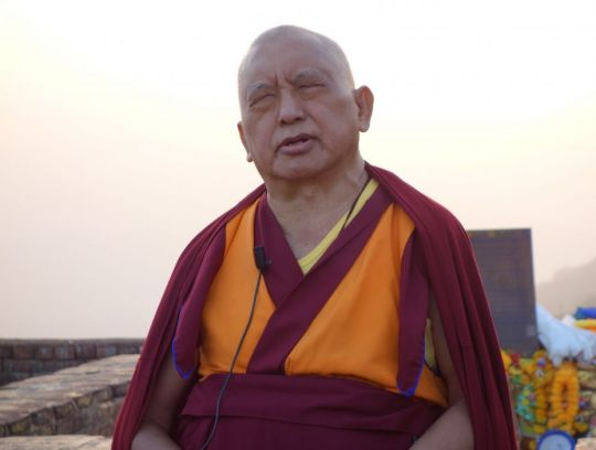 Lama Zopa Rinpoche teaches on the Heart Sutra as the sun begins to set, Vulture's Peak, Rajgir, India, February 2014. Photo by Ven. Roger Kunsang.