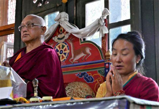 Lama Zopa RinpochewithKhadro-la(Rangjung Neljorma Khadro Namsel Drönme) atoneoftheholiestplacesinBhutan, KyichuLhakhang, doing Guru Puja with tsog offering, Bhutan, May 2016. Photo by Ven. Roger Kunsang.