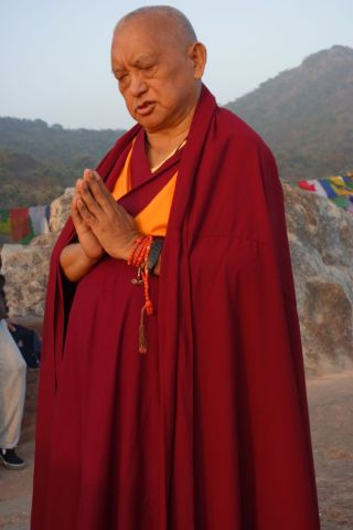 Lama Zopa Rinpoche does prostrations at Vulture's Peak, the site of Buddha's first teaching, Rajgir, India, February 2, 2014. Photo by Ven. Roger Kunsang.