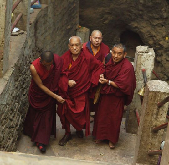 Lama Zopa Rinpoche ascending the stairs of the Maratika Caves, Nepal, February 2016. Photo by Ven. Thubten Kunsang.