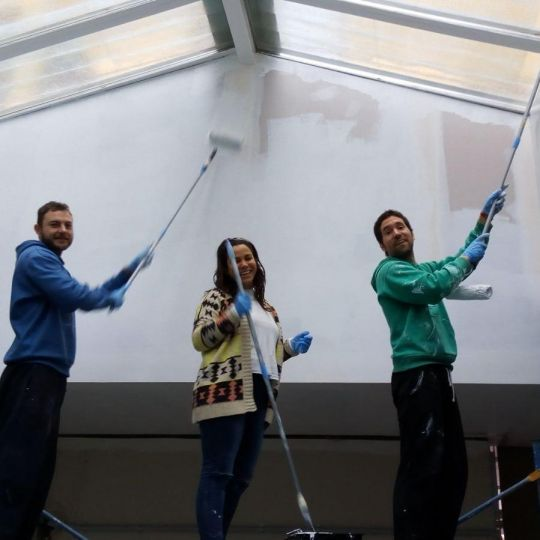 Volunteers painting the ceiling of Centro La Sabiduría de Nagarjuna's new center, Bilbao, Spain, February 2018. Photo courtesy of Centro La Sabiduría de Nagarjuna's Facebook page.