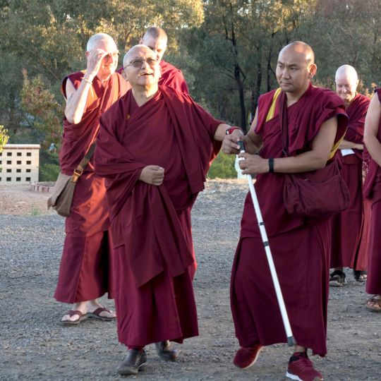 lama-zopa-walking-great-stupa-201804