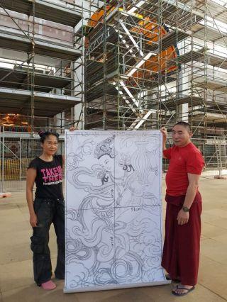 Lucy and Ven. Lobsang Konchok holding an image of a dakini inside of The Great Stupa, Bendigo, Australia, January 2018. Photo courtesy of Ian Green's Twitter page.