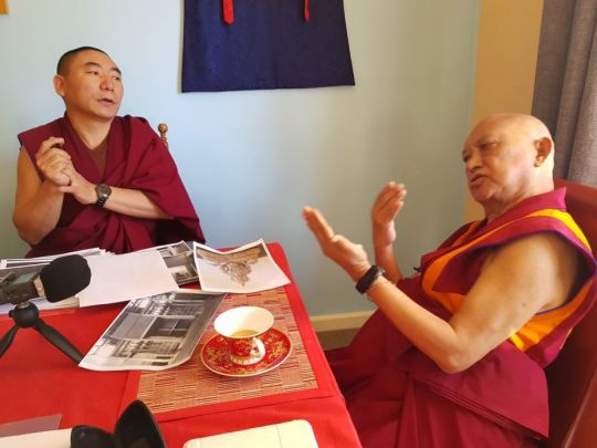 Lama Zopa Rinpoche and Ven. Lobsang Konchok discussing artwork for The Great Stupa, Bendigo, Australia, April 2018. Photo courtesy of Ian Green's Twitter page.