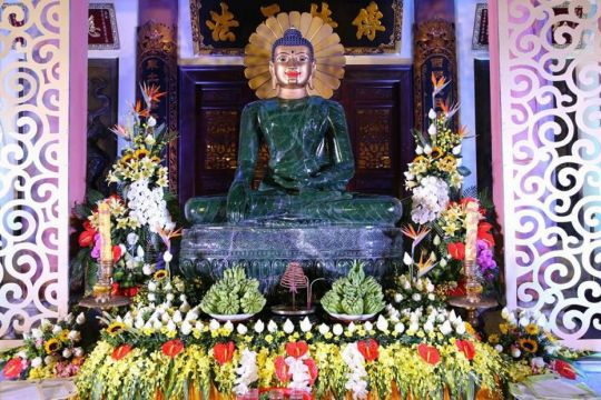 The Jade Buddha surrounded by floral offerings after the unveiling at Yen Phu Temple, Hanoi, Vietnam, June 2016. Photo courtesy of Ian Green's Twitter page.
