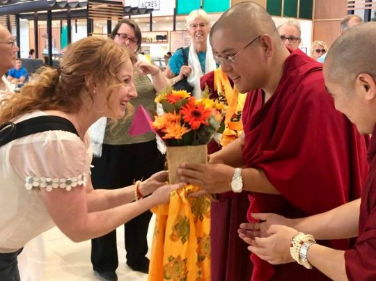 H.E. Ling Rinpoche greeted at Perth Airport by Kirsti Kilbane, Perth, Western Australia, March 2018. Photo courtesy of Jude Milan.
