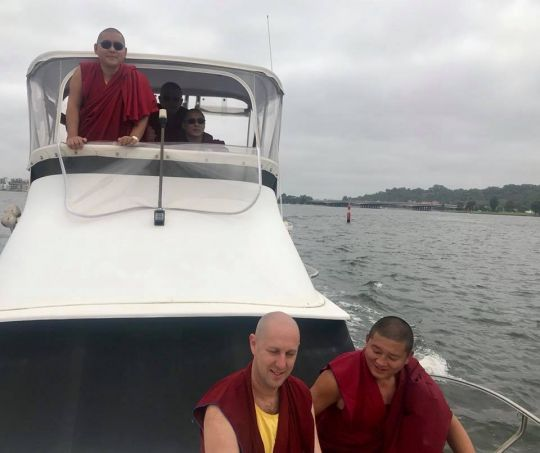 H.E. Ling Rinpoche, Ven. Tenzin Khentse, Geshe Lobsang Yonten, Ven. Kartsön (Yaki Platt), and John Waite enjoying a boat ride on Swan River, Perth, Western Australia, March 2018. Photo courtesy of Kirsti Kilbane.