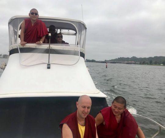 H.E. Ling Rinpoche, Ven. Tenzin Khentse, Geshe Lobsang Yonten, Ven. Kartsön (Yaki Platt), and John Waite enjoying a boat ride on Swan River, Perth, Western Australia, March 2018. Photo courtesy of Kirsti Kilbane.