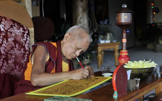 Lama Zopa Rinpoche writing out a mantra, Buddha Amitabha Pura Land, Washington, US, September 2016. Photo by Ven. Losang Sherab.