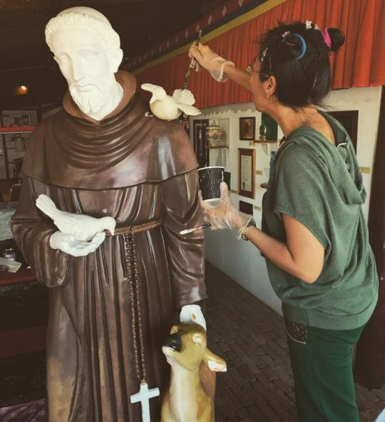 Lucy Wang painting the Saint Francis of Assisi statue, Bendigo, Australia, May 2018. Photo courtesy of The Great Stupa's Instagram page.