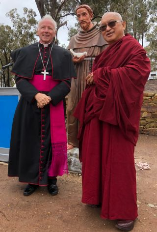 Bishop Leslie Rogers Tomlinson and Lama Zopa Rinpoche with the statue of Saint Francis of Assisi, Bendigo, Australia, May 2018. Photo by Ven. Roger Kunsang.