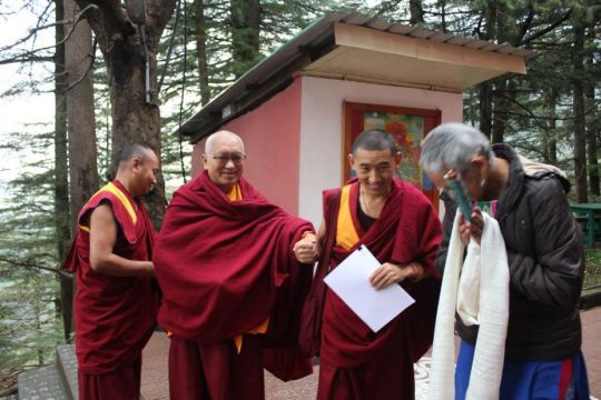 Lama Zopa Rinpoche on his way to meet with the Introduction to Buddhism course students at Tushita Meditation Centre with Ven. Thubten Tendar, Ven. Sangpo, and acting center director Archhana Kombrabail, Dharamsala, India, February 2017. Photo courtesy of Tushita Meditation Centre's Facebook page.
