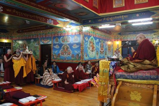 Sangha approaching Lama Zopa Rinpoche with the tsog offering during Guru Puja, February 2017. Photo courtesy of Tushita Meditation Centre's Facebook page.