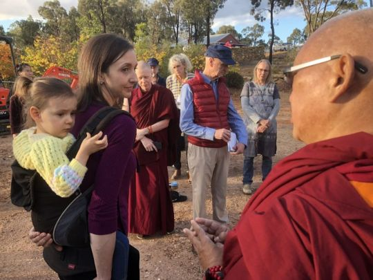 Lama Zopa Rinpoche blessing a child May 5 2018 by Ven Roger Kunsang