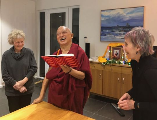 Natalie Playford and Judy McDonald who cooked for Lama Zopa Rinpoche sharing a moment with Rinpoche as he had us print mantras in a book to see who had the most merit to print the perfect mantra