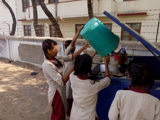 Children emptying trash bins Maitreya School April 2018 by Pema Tsering