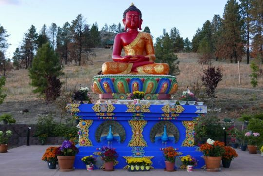 The incredible Amitabha statue at Buddha Amitabha Pure land, with flower offerings Sept 4 2016 by Ven. Roger Kunsang