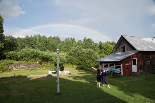Sarah-Brooks-and-Drolkar-McCallum-under -a-double-rainbow-at-Milarepa-Center-July-2018-photo-by -Dawn-Holtz