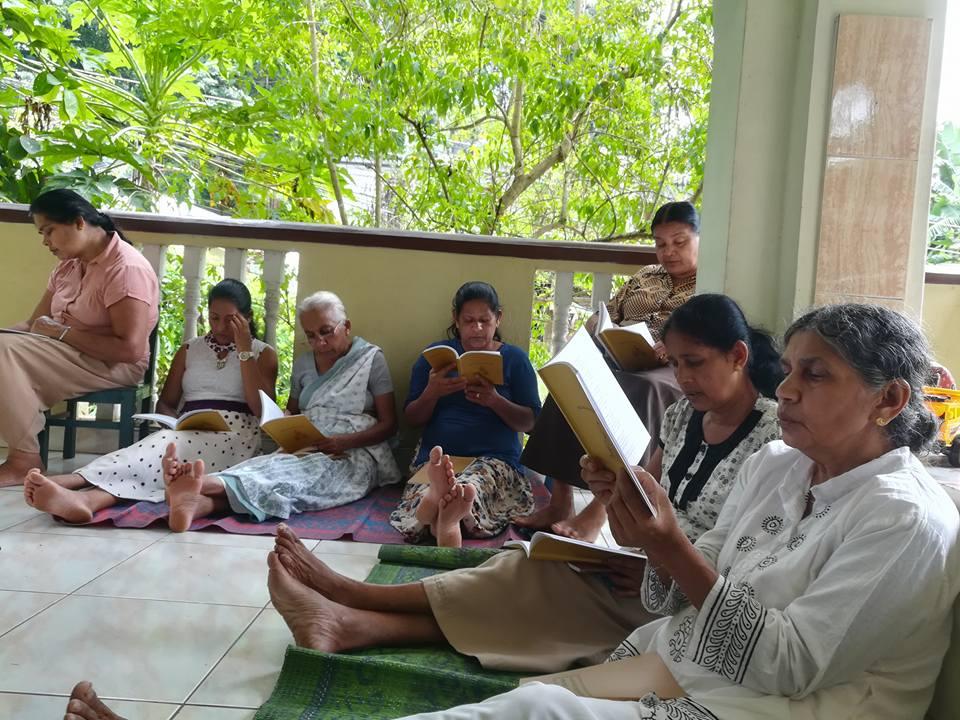 Group of people sitting outside recitating the Golden Light Sutra as an offering to Lama Zopa Rinpoche, Aranayaka, Sri Lanka, November 2017. Photo courtesy of Ven. Tenzin Lekdron.