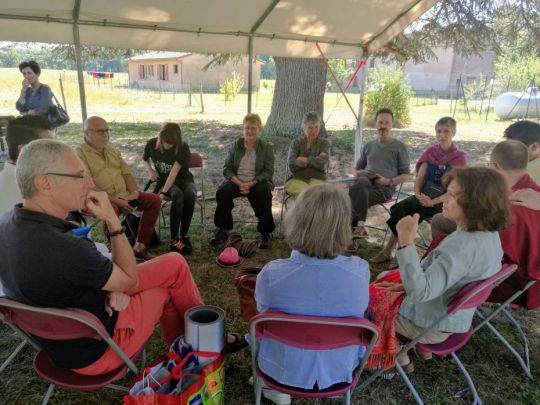participants-discussing-compassion-in-a-circle-at-the-intersangha-gathering-at-nalanda-monastery-in-france-september-2018-by-nalanda-monastery