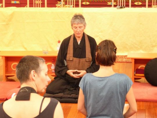 practitioner-leading-a-practice-at-the-intersangha-gathering-held-at-nalanda-monastery-in-france-in-september-2018-by-nalanda-monastery