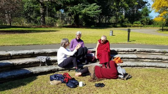 students-engaged-in-discussion-outside-in-the-sun-during-a-vajrasattva-retreat-with-venerable-robina-courtin-held-at-peter-canisius-house--australia-in-september-2018-photo-by-vajrayana-institute