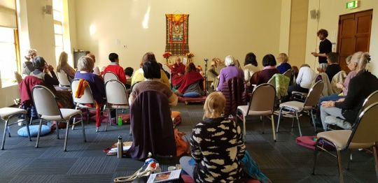 venerable-robina-courtin-teaching-a-large-group-of-students-inside-at-peter-canisius-house-in-pymble-australia-during-a-vajrasattva-retreat-september-2018-photo-by-vajrayana-institute