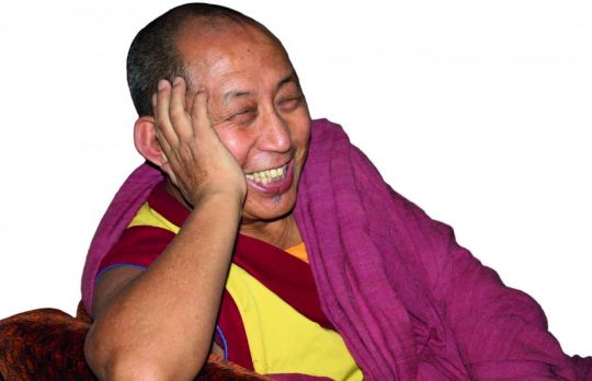 geshe-sonam-gyaltsen-also-known-as-geshe-dhonden-sitting-on-a-chair-smiling-in-the-year-2014-photo-from-the-maitreya-instituut-picture-collection-used-with-permission-of-jeroen-collier