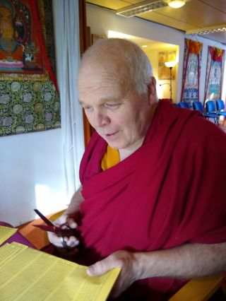 ven-konchog-phuntsok-also-known-as-jan-bijman-holding-a-sheet-of-mantras-photo-courtesy-maitreya-instituut-amsterdam