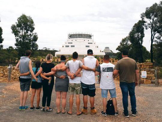 alcohol-and-other-drugs-program-participants-gazing-with-arms-locked-at-the-great-stupa-of-universal-compassion-in-bendigo-australia-january-2019-by-alyce-crosbie