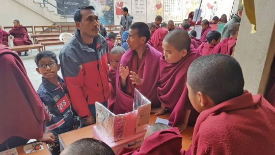kopan-monastery-school-student-venerable-lhundub-pelkar-explaining-his-team-project-at-schools-science-fair-january-13-2019-kopan-monastery-kathmandu-nepal-photo-by-kopan-monastery-school