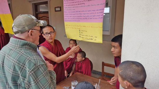 kopan-monastery-school-students-venerables-lobsang-choezin-and-lobsang-jampa-explaining-at-school-science-fair-jan-13-2019-kopan-monastery-kathmandu-nepal-photo-by-kopan-monastery-school