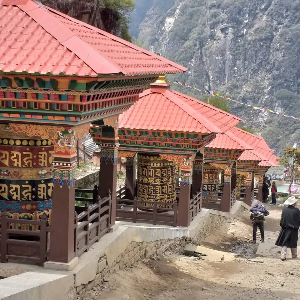 Prayer wheels turned by water which bless the entire area.