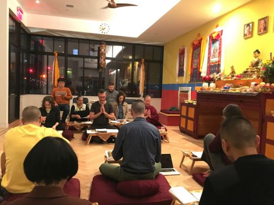 Venerable Amy Miller and a group of students reading prayers in the Shantideva Center gompa