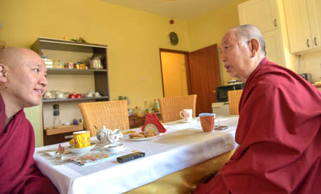 Zong Rinpoche and Geshe Sonam Gyalsten seated at a kitchen table in conversation in Loenen the Netherlands