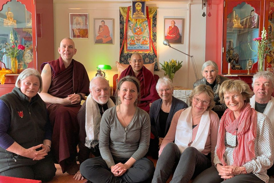 Ling Rinpoche with a small group of students seated in front of a room with holy objects at Maitreya Instituut Amsterdam