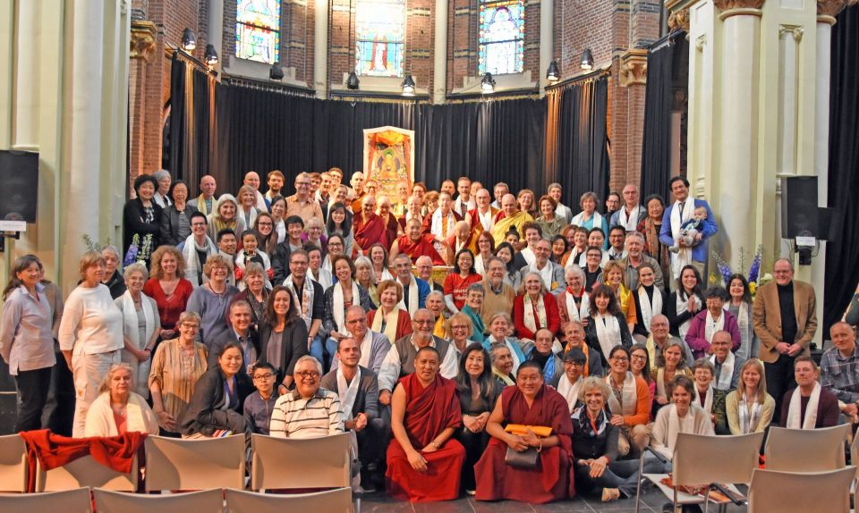 Ling Rinpoche posed with a large group of students inside of a beautiful old church in Amsterdam