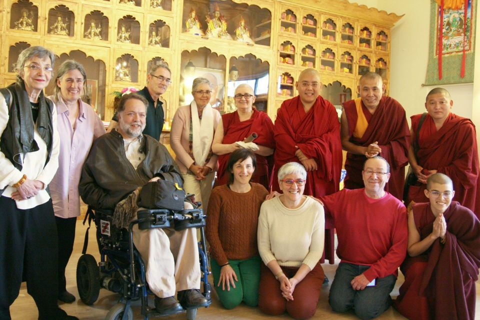 Ling Rinpoche posing for a photo with a group of students inside of a Buddhist center in Barcelona.