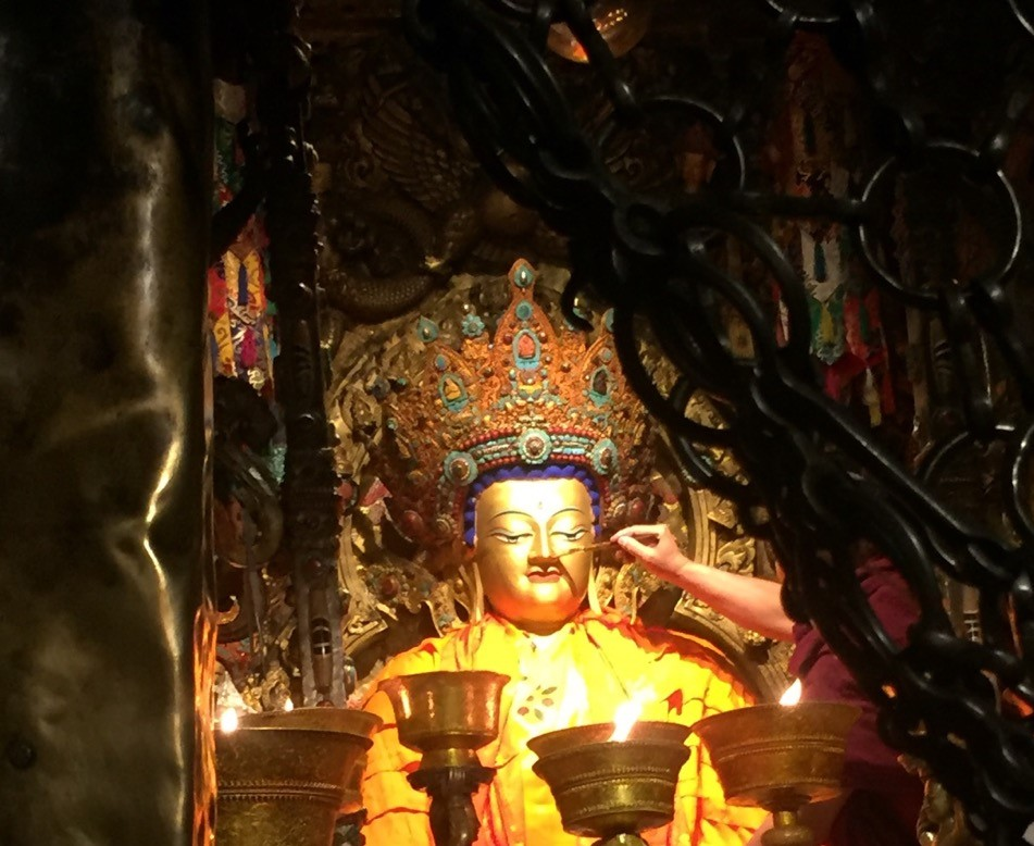Monthly Offering of Gold and Robes to Precious Buddha Statue in Tibet