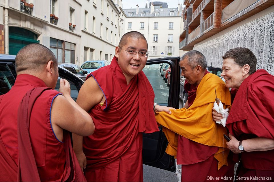 His Eminence Ling Rinpoche smiling at the camera just before stepping into the car to leave Kalachakra Center in Paris.