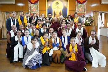 A large group from LRZTP posed for a group photo with His Holiness the Dalai Lama in the center of the photo.