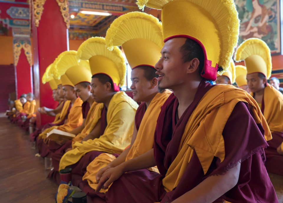 monks doing puja