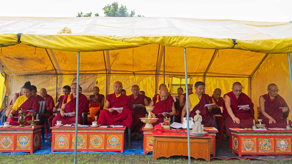 lamas and sangha doing incence puja in tent outside