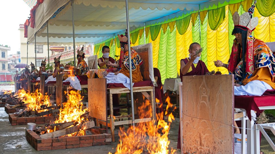 lamas doing fire puja outside