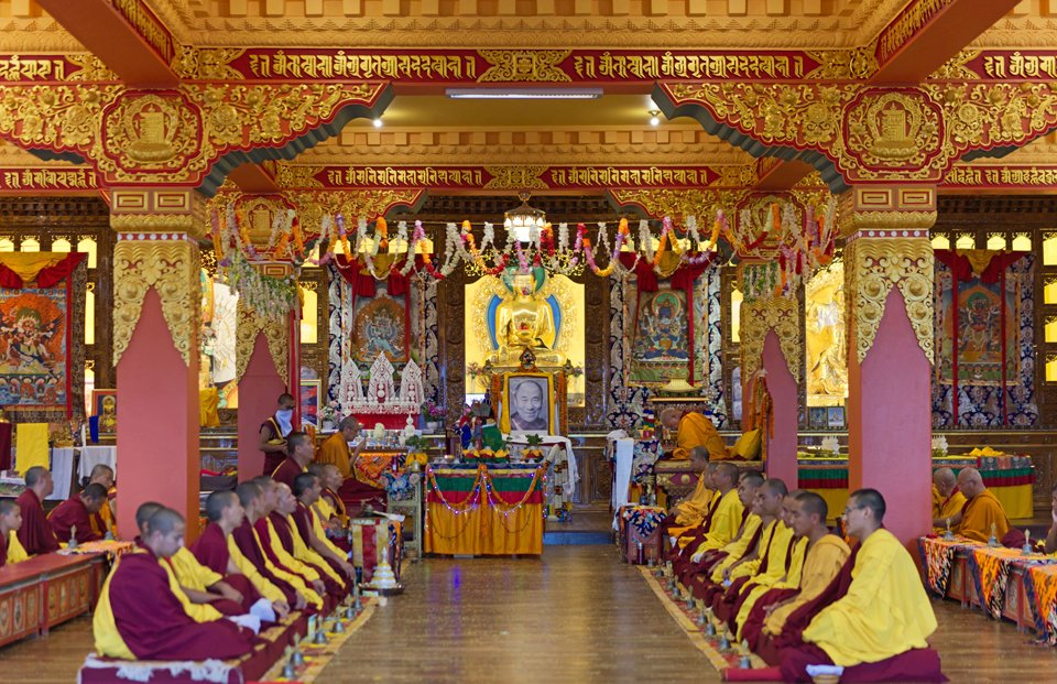 monks doing puja in a gompa