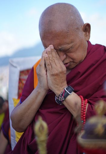Lama Zopa Rinpoche with hands together in prayer