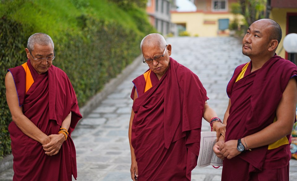 Khen Rinpoche and Lama Zopa Rinpoche, assisted by Ven. Thubten Tendar, on path at Kopan Monastery